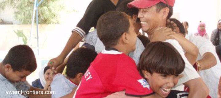 Photo of worker with children in Middle East